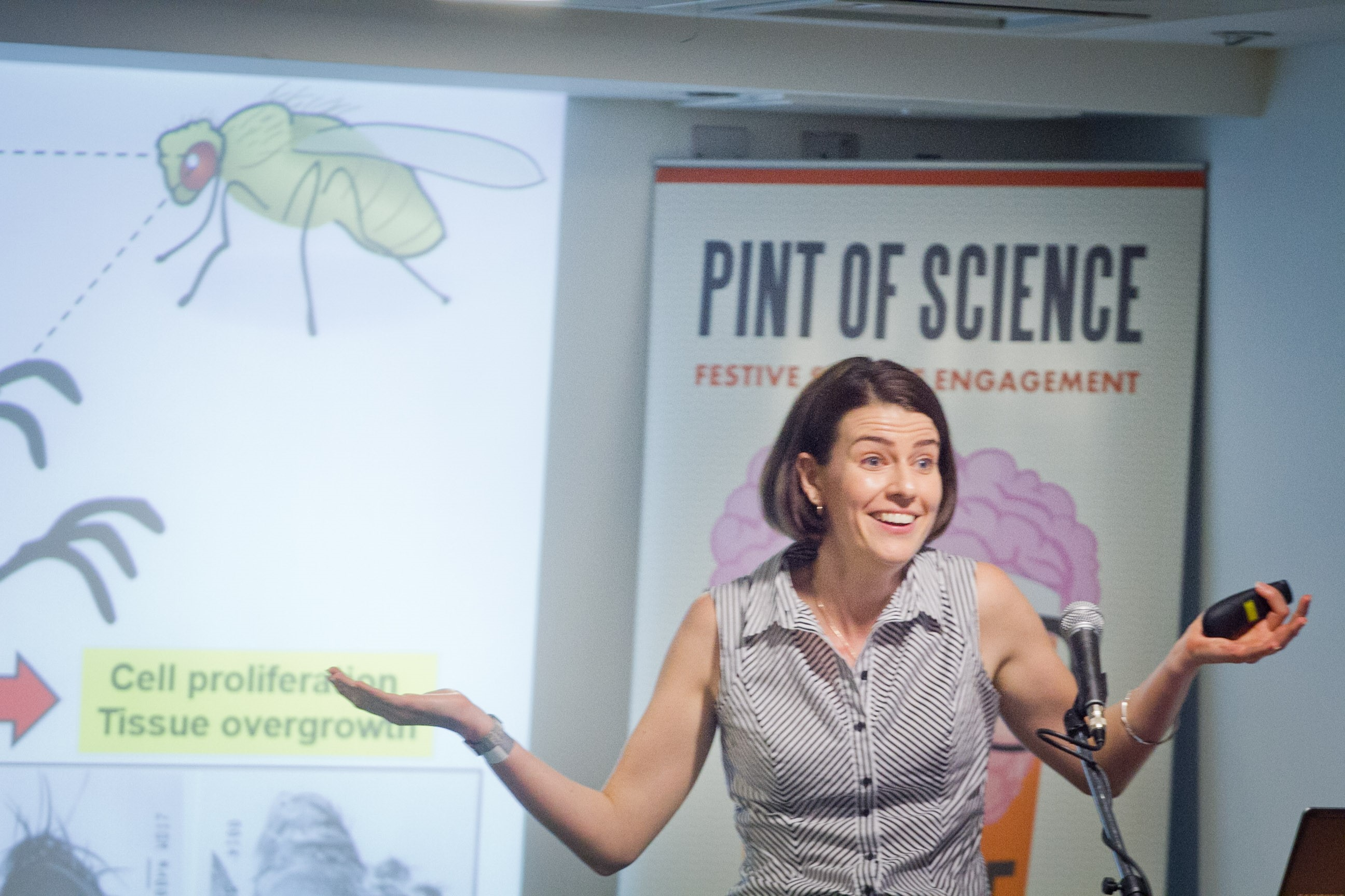 Aussie Scientist Dr Rachael Barry of Imperial College London explaining how fruit flies can be used to model undead cells. Photo credit: The London Lens Project.