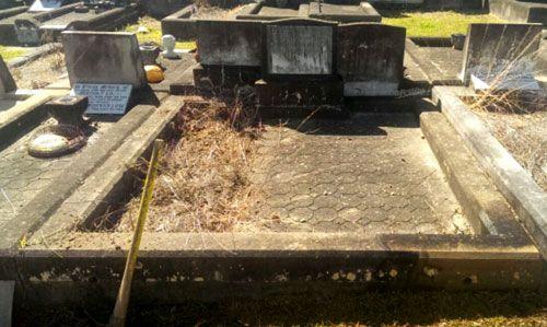 Damaged gravestone