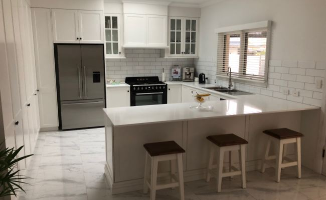 Marble Tiled Floor White L-Shaped Kitchen