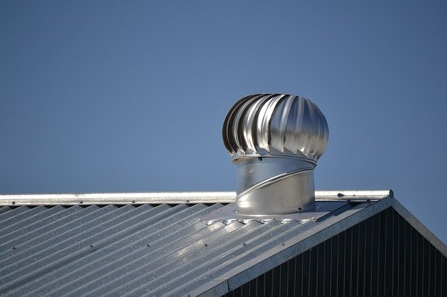 Metal roof with whirlybird