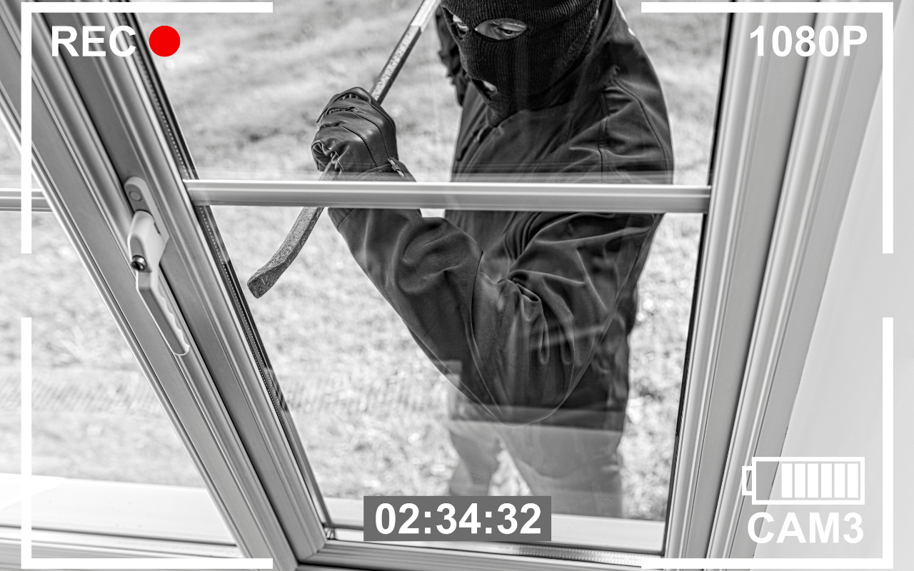 Security Camera recording a person breaking into window