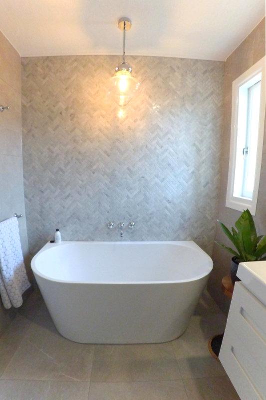 Herringbone tiling in bathroom renovation