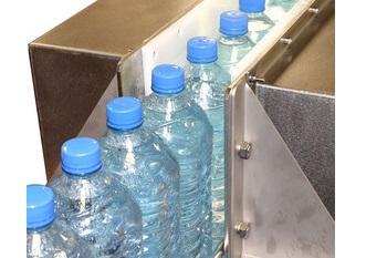 Air drying plastic bottles on a conveyor line