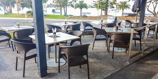 Sanitising tables & chairs for customers